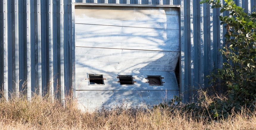 While this broken garage door might be beyond repair, a garage door fix is the best option than total replacement.
