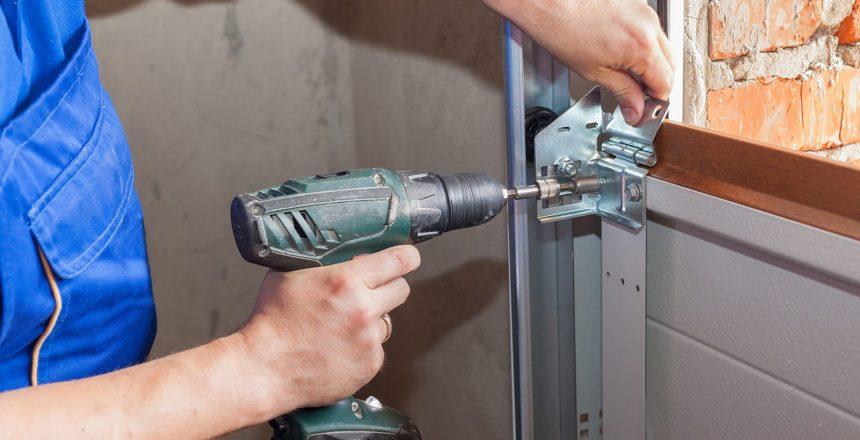 Environmental Door knows how to build a custome garage door, but now you can too with our online tool. A garage door technician installs a door panel.