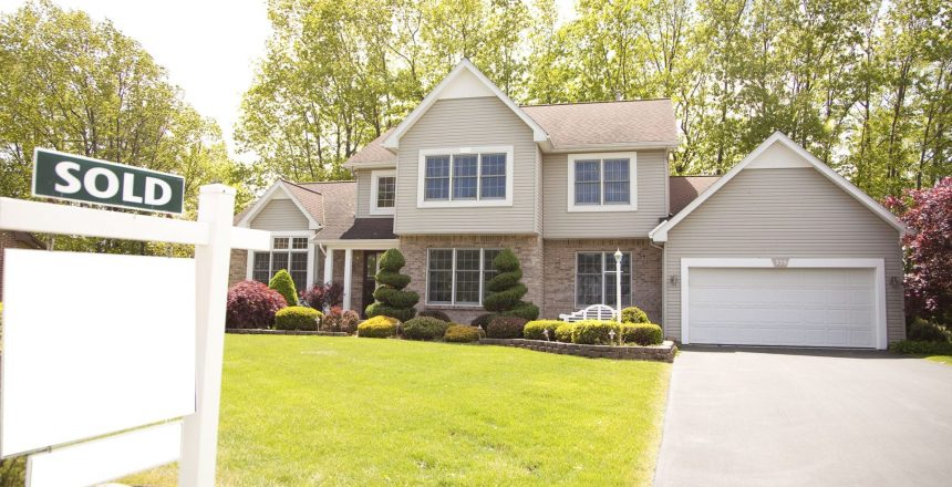 After buying a new house, consider a new garage door installation as your redesign kickoff. A newly sold house with an outdated garage door.